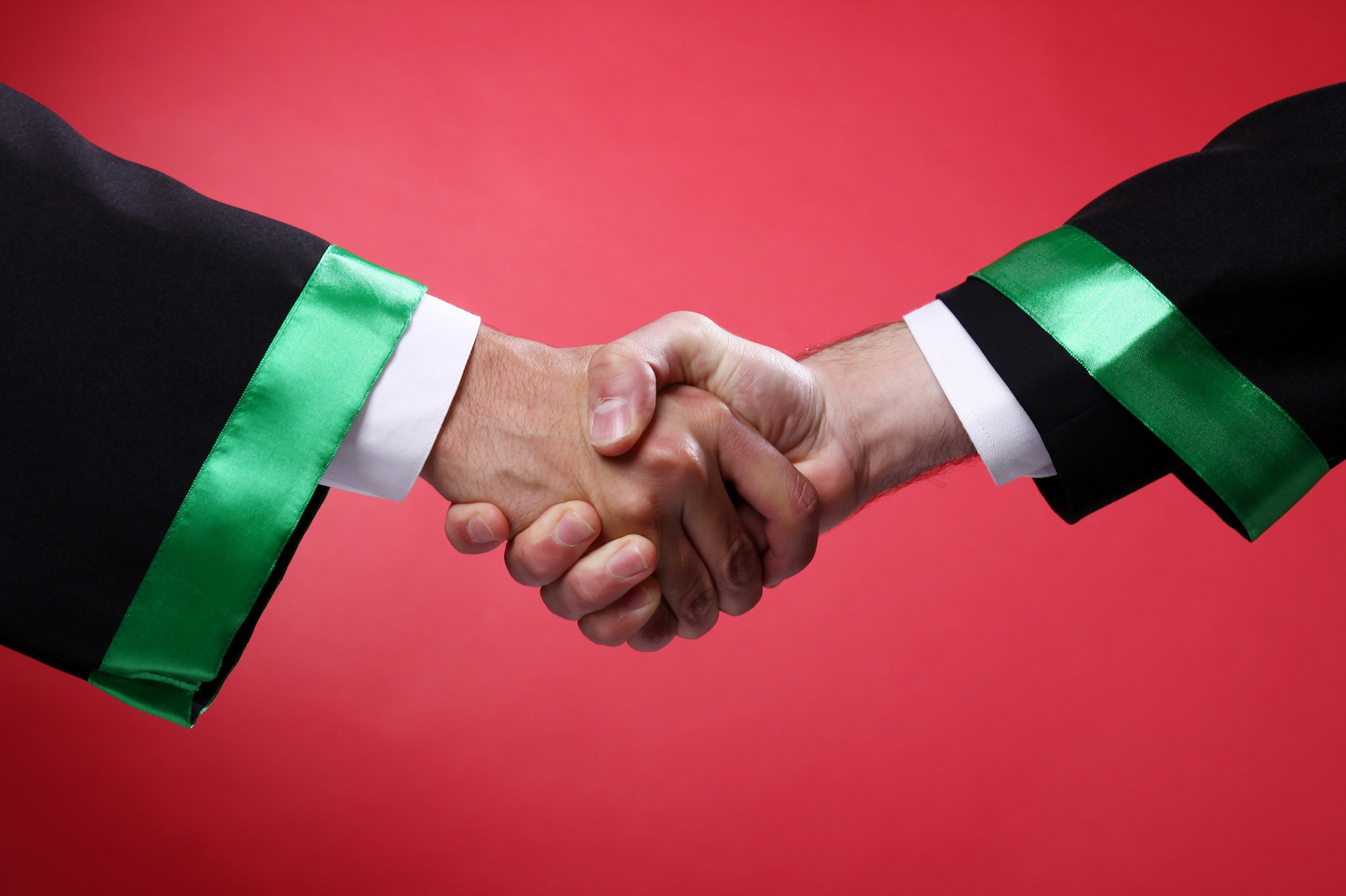 Two hands with green-trimmed sleeves